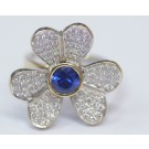 An 18 Carat White Gold Flower-Shaped Ring Set With 104 Diamonds 1-2 pt.  VS \ H and 1/2 carat sapphire.